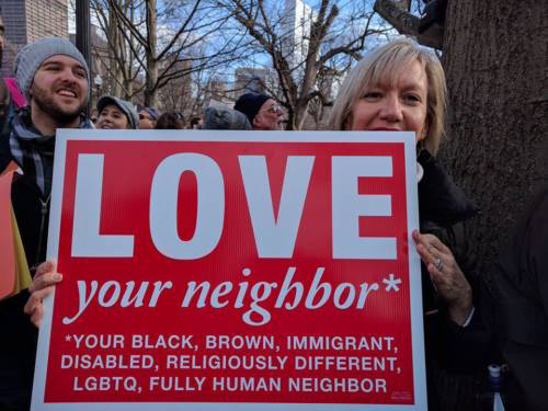 Love Your Neighbor Sign by Impact Printing At Women's March on Boston January 2017.